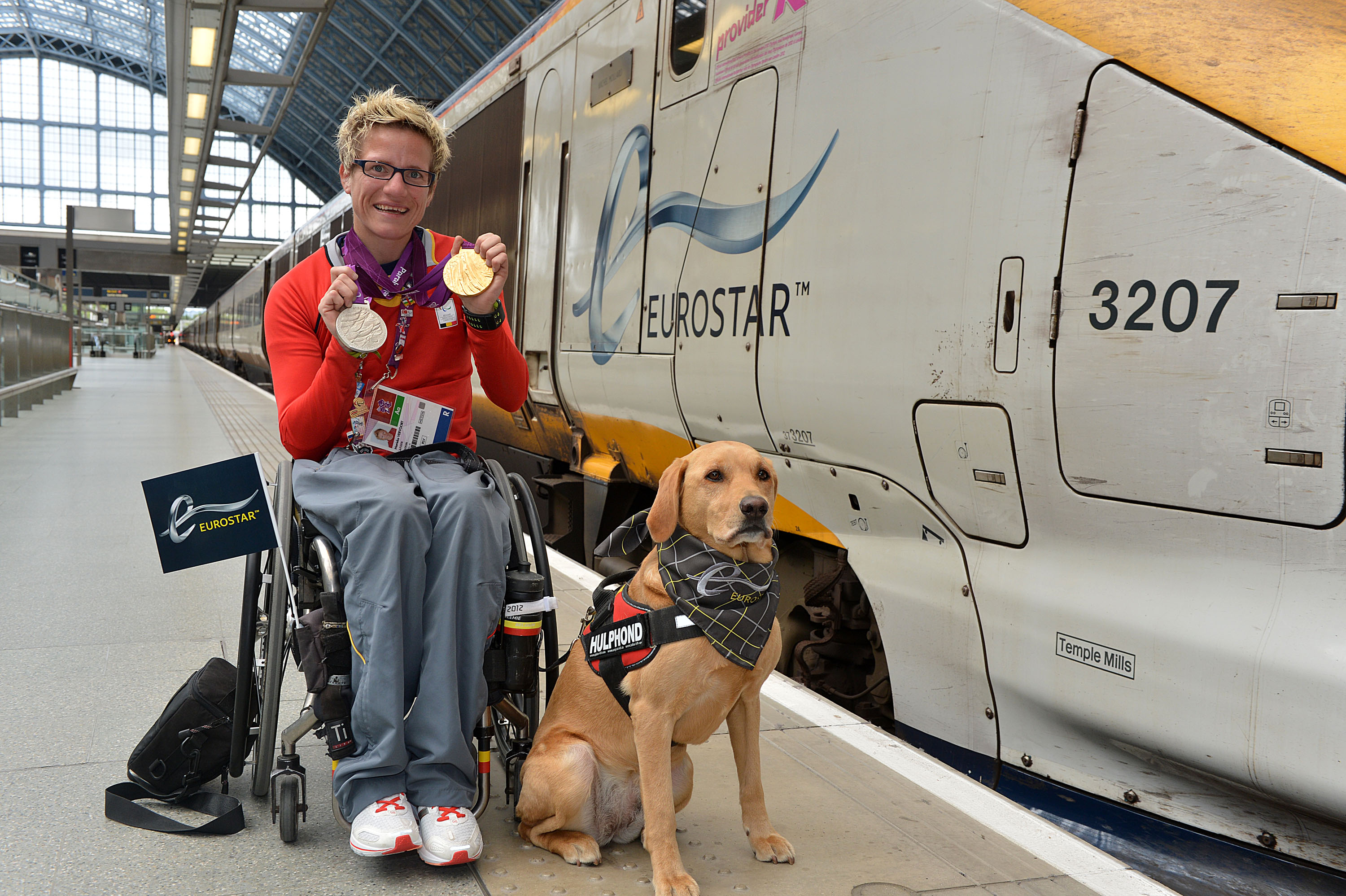 Belgian Paralympic 100m Gold and 200m Silver  medalist Marieke Vervoort and 'Help Hound' Zenn leave  the Eurostar terminal at  St. Pancras, London, UK, on Monday, Sept. 10, 2012. (Photo by Mark Allan/AP Images for Eurostar)